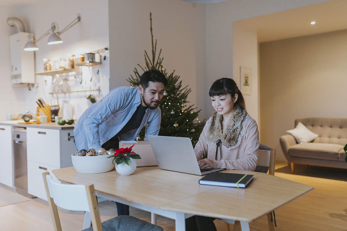couple looking at budget during the holiday season